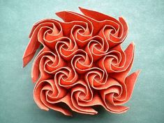 13 Kawasaki Roses by John McKeever folded from a sheet of elephant hide paper