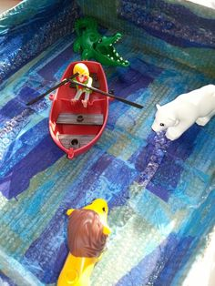 Small world. Tissue paper, bubble wrap & sparkly paint inside a small cardboard box. Props for Row row row your boat nursery rhyme. Also used box for a sailor went to sea sea sea, 1, 2, 3, 4, 5 once I caught a fish alive, 5 little speckled frogs, 5 little ducks.