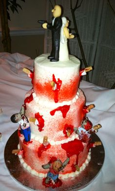 Zombie wedding cake. Fondant zombies and bride & groom. Piping gel blood