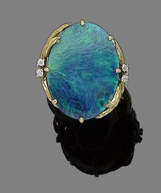 A gold, black opal, and diamond ring #opalsaustralia