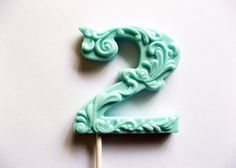 "3"" fancy filigree number 2 hard candy lollipops As seen in Dylan Lauren's bridal shower featured in Martha Stewart weddings May 2011. $9.75, via Etsy."