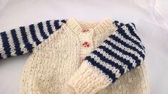 Chunky knit sweater for newborn. Measures 17inches (43cms) around chest. Cream and navy baby jacket, striped sleeves flowery buttons. by Nobodyknitsitbetter on Etsy