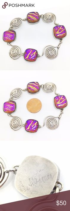 """*SALE* Bracelet Artisan Glass Statement Beautiful!! Artisan made statement bracelet in sterling silver with spirals and hand fused glass detail. Glass quality is amazing: sparkling orange pink base color with gold undertones; layered with iridescent blue and gold organic lines. Measures 7.5"""" length, 5/8"""" wide, 1/4"""" thick. Hook closure. Stamped 'STERLING' and signed by the artist 'A Paskiewicz'. Made in USA. This piece has a nice weight, comfortable to wear. Perfect on its own or in addition…"""