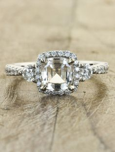 1.45ct peach sapphire and 0.53 carats of dazzling, sparkling diamonds, set in 14k white gold.