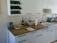 butcher block countertop with plain cabinets