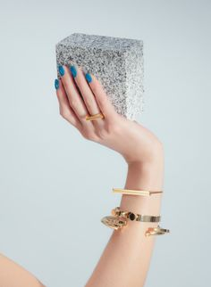 Qui Yang jewelry editorial.  Gold bracelet and rings with marble accent #stilllife #fashion