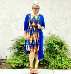 Be bold! Layer a bright sarah over a geometric Amelia in bold colors for a statement outfit! Come shop with me: https://m.facebook.com/groups/959875900732460 #lularoe #lularoeamelia #lularoesarah #sarah #amelia #justfab #dresswithpockets #lularoeoutfit #outfit #styling #pixiecut #browlineglasses #lularoestylist