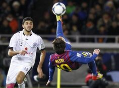 Lionel Messi of Spain's Barcelona attempts an overhead shot near Ibrahim Abdulmajed of Qatar's Al Sadd during their Club World Cup semi-final match in Yokohama, south of Tokyo, December 15, 2011.  REUTERS/Kim Kyung-Hoon
