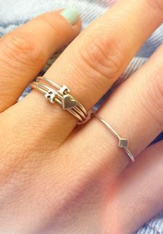 Get the skinny on these dainty, stackable alphabet rings! .