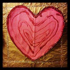 Day 16: Mauricio Family Advent Calendar | A New Heart that Loves God.  Calendar Piece: Glittering heart.  Constructed of Card, construction paper, glitter glue, magnet on rear.