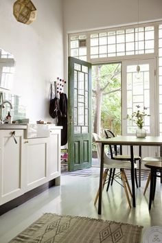 A beautiful Gothenburg home with a hint of English style --- love the door