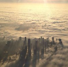 NYC tries to be like San Francisco - Two beautiful aerial photos of New  York shrouded in fog this morning 94e692c22
