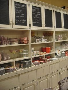 Amazing Boutique Display Idea. Keep boxed items in cabinets and drawers. Use shelving for display, chalk front cabinets for fun info, ideas. How about magnetic chalk for another layer of fun?? Great for minimal space.