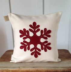All of my pillows covers are handmade by me in my home studio.    This pillow cover is made with a decorator fabric. The snowflake is hand cut by
