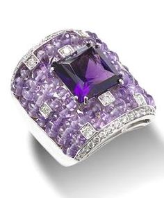 An amethyst and diamond ring The square-cut amethyst, to a broad band set with seven-rows of amethyst beads, decorated by brilliant-cut diamonds, mounted in 18k white gold, the principal amethyst estimated to weigh approximately 8.00 carats,