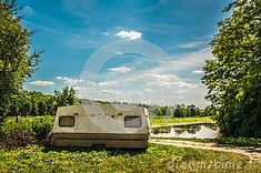 Photo about Old caravan standing next to the road with blue sky and water. Image of caravan, landscape, mobile - 120067584 Caravan, Sky, Stock Photos, Landscape, Water, Blue, Image, Heaven, Gripe Water