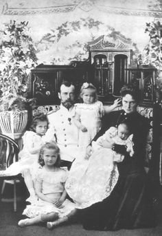 A formal family portrait taken on the occasion of Grand Duchess Anastasia's christening, 1901.From left: Grand Duchesses Tatiana and Olga, Nicholas II, Grand Duchesses Maria and Anastasia, and Alexandra Feodorovna (wearing mourning in memory of her Grandmother, Queen Victoria who had died that January.)
