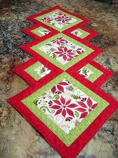 Unusual patchwork table runner - from a forum but link to the pattern is here: http://www.quilterswarehouse.com/p-19118-accent-your-focus-table-runner-pattern.aspx