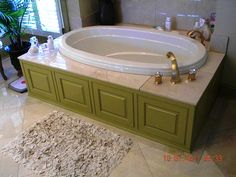 We used panels on the tub surround to tie it in with the cabinet