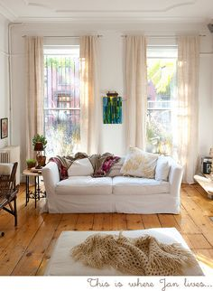 Bright, light, livable room.  Makes me want to curl up there with a book and a cup of tea.  (The art is a bit distracting.)