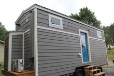 Every Tiny Moment Tiny House on Wheels Model is built by Brevard Tiny House. It is an ft. tiny home featuring a loft walkway, floor storage, and a large. Tiny House Company, Tiny House Swoon, Tiny House Listings, Tiny House Plans, Tiny House On Wheels, Tiny House Exterior, Grey Exterior, Exterior Colors, Tiny Houses For Sale