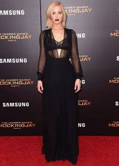 Jennifer Lawrence wears a sheer dress with a lace bra layered underneath