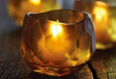 NEW! Amber Rock Tealight Holder Artfully-cut glass in a warm amber tone creates a mesmerizing focal point when set aglow. For use with a tealight or large tealight, sold separately.