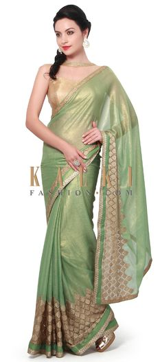 Buy Online from the link below. We ship worldwide (Free Shipping over US$100). Product SKU - 306189.Product Link - http://www.kalkifashion.com/green-foil-saree-adorn-in-zari-border-only-on-kalki.html