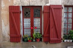 a ribbon at a time — girlyme: Red Shutters, Rochechouart, Limousin,. Window Shutters Exterior, Red Shutters, Outdoor Shutters, Red Cottage, Cottage Style, Door Steps, Interior Windows, Shutter Doors, European Home Decor