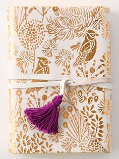 this journal gave me the gift-wrapping idea for a leather ribbon, finished with a jaunty little tassel.  A nice DIY topper on a pretty, stamped DIY paper.