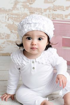 aw14: There's one word for Lemon Loves Layette's pure white ruffled set: irresistible. www.lemonloveslayette.com