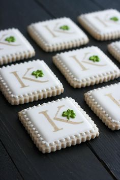 Irish monogram cookies for St. Patrick's Day! Gold luster dust stenciling technique and royal icing clovers make these sugar cookies special.