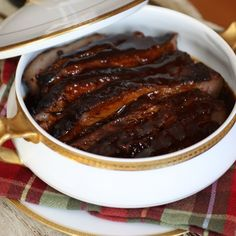 Slow-Cooker BBQ Beef: So tender and succulent it melts in your mouth. Fiery hot with a hint sweet and savory, your taste buds will be doing a jig with this dynamic slow-cooked barbecue beef recipe! #slowcooker #bbq