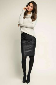 High waisted black leather skirt and white sweater outfit