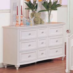 Your little girl is sure to love the jeweled hardware and carved ribbon detail of the Crystal collection. It is finished in a bright white with framed drawer fronts and turned feet that add personality to the collection. The low post bed has a high headboard built for a princess. The desk hutch features a corkboard back and ribbon apron detailing. Give your little girl the room she's always dreamed of with the Crystal collection.