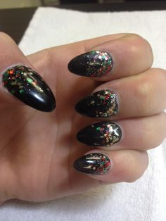 Black Stiletto Nails with Christmas Green, Red And Gold Glittler