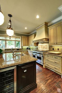 I like this Kitchen and oven hood. Plus the wine cooler under the #kitchen #island