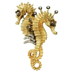 Sorab & Roshi Golden Seahorse Pin | From a unique collection of vintage brooches at https://www.1stdibs.com/jewelry/brooches/brooches/