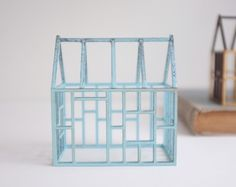Miniature architectural framework house in pale blue stained birch. $35.00, via Etsy.