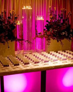 Feeling inspired by this gorg #pink #tableglow effect for the name tag table. Photo via #evantine
