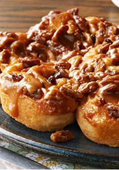 Easy Caramel Sticky Buns – Refrigerated crescent dough is topped with sugar, cinnamon, pecans, and raisins, rolled up, sliced, and baked in gooey caramel for a breakfast treat that's sure to please any crowd.