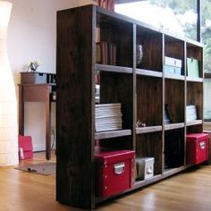 If you're living in a small apartment or studio, bookshelves also make great room separators.
