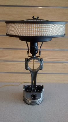Having a hard time finding that perfect gift. Look no further then our Piston lamp. It would look great in any caveman or office. This is a custom Piston lamp with a 10 inch Edelbrock air filter for a lampshade.