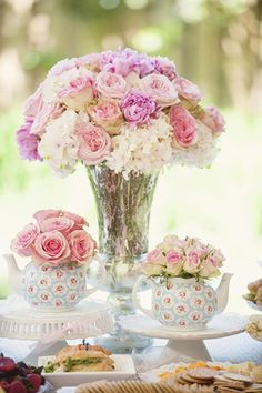 Tea party tablescape with pastel roses & hydrangea. Love the little teapots used as vases!