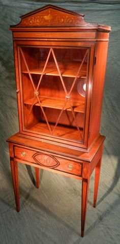 Painted Federal Style Curio Cabinet...get this look with Chalk Paint™ in Barcelona Orange, then clear and dark wax.