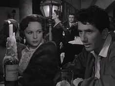 """Amália Rodrigues sings the fado """"Barco Negro"""" in a scene from Henri Verneuil's 1955 film LES AMANTS DU TAGE.    The interspersed French dialogue, which contains the most important lyrics, is closed captioned in English. Enable CC in the lower right hand corner of the Youtube player to see the captions in the language of your locale."""