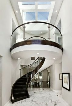 spiral staircase with glass panel handrail