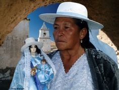 Chilean woman, interesting the doll is dressed exactly like her and she probably selling them