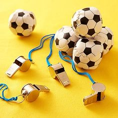 Kids+can+play+coach+at+home+with+a+metal+whistle+and+a+mini+soccer+ball+from+a+party+store.