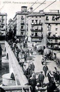"""El Pont de Pedra de Girona. Girona Stone Bridge as the locals call it. The real name is """"Isabel II Bridge"""" and here next to Carrer del Progres. (Date and Photographer unknown) Catalonia 